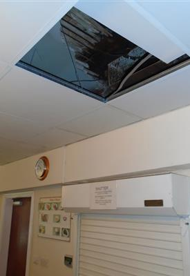 A torn away ceiling above a ceiling tile at the Alsager care home