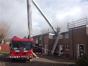 Firefighters and the hydraulic platform outside a block of flats in Northwich, where there was a roof fire