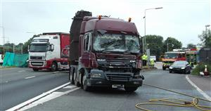 Two lorries and a fire engine at the scene of a road traffic collision on the M6 today