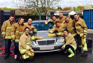 Washing cars for the National Fire Fighters Charity car wash