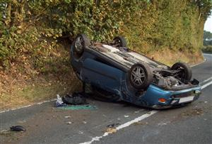 Car on its roof in Northwich