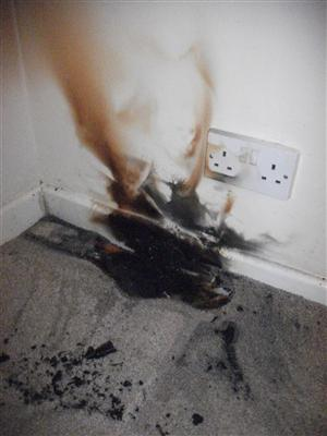 Damage caused by a phone charger fire in Warrington