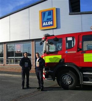 Firefighters outside Aldi ready to give driving safety advice to shoppers