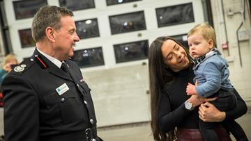 Jade Broderick with her 10-month-old son Blake and Cheshire Fire and Rescue Service's Assistant Chief Fire Officer Gus O'Rourke, who rescued her from her blazing bedroom 24 years ago
