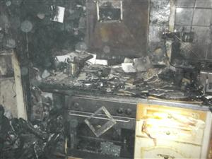 Damage caused to kitchen after chip pan fire
