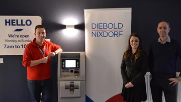 Mark is pictured here with Lucy Jenkins, Diebold Nixdorf's UK and Ireland Marketing Manager, and Paul Ferris, Product Specialist.