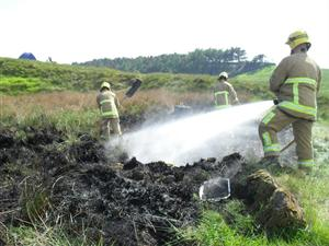 Cheshire Firefighters tackling a grass fire at Lyme Country Park