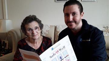 Gwen Pugh receiving a Safe and Well Visit from Kris Greenall, a member of Cheshire Fire and Rescue Service's prevention team