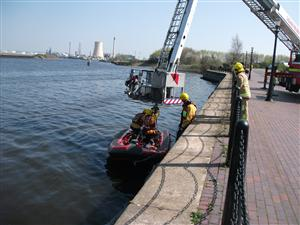 The water rescue boat being launched onto the Manchester Ship Canal