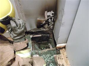 Firefighters cut away flooring to extinguish fire