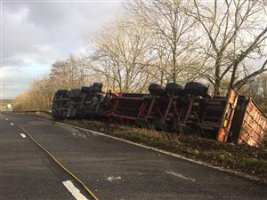 Overturned lorry on M56