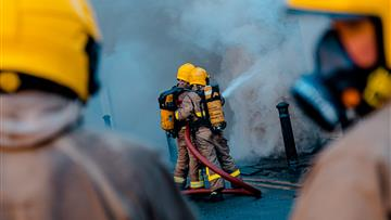 Firefighters tackling fire in breathing apparatus