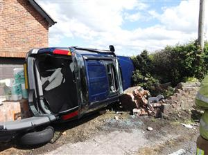 Firefighters were called to a car on its side and a woman trapped in Prestbury.