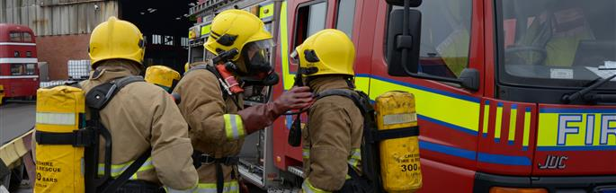 Firefighters and a fire engine at a training exercise