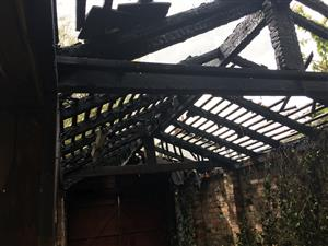 Fire destroyed the outbuilding roof