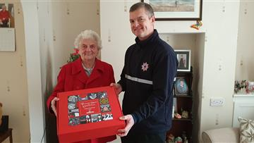 Runcorn firefighters deliver Howdens hampers during Safe and Well Visits
