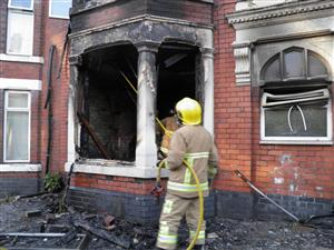 Firefighters at the scene of a fire in Crewe