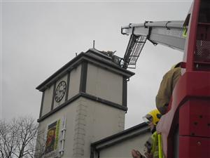 Firefighters work to secure roof on Winsford Cross clock tower