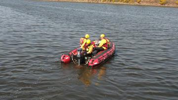 Firefighters using their boat on Manchester Ship Canal