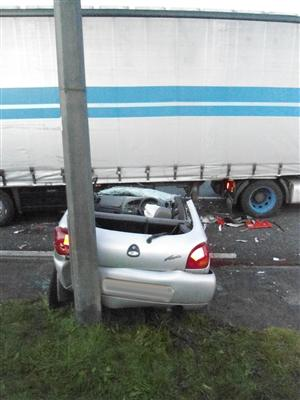 Aftermath of road traffic collision involving a car and HGV