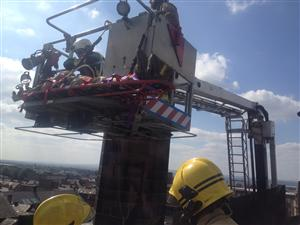 The casualty is lifted onto the aerial appliance