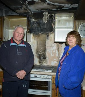 David and Margaret Gill in their fire damaged kitchen