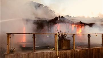 Wooden lodge on fire in Eaton