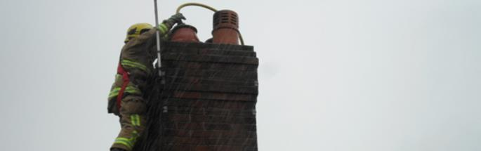Cheshire firefighters dealing with a chimney fire