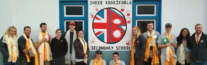 Apprentices and leaders outside the school