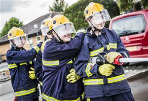 Cheshire Fire Cadets using a hose