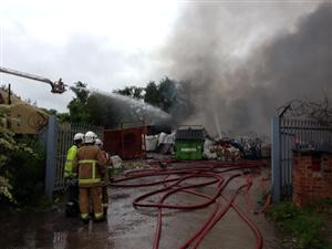 Firefighters tackling a large blaze in Ellesmere Port