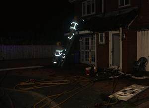 Firefighters extinguishing a house fire in Widnes