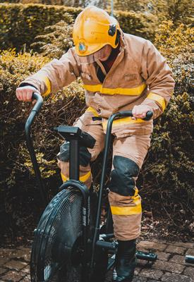 Trainee firefighter cycling