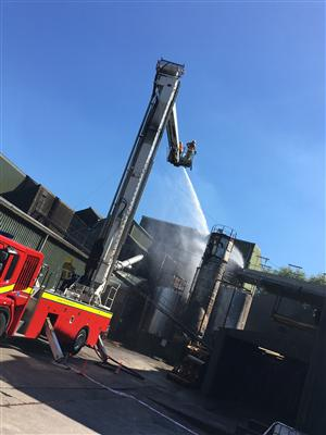 Hydraulic platform dealing with a silo fire in Cranage