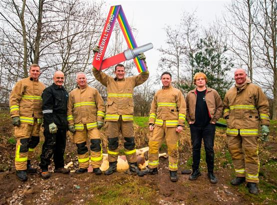 Firefighters celebrating Cheshire Fire's Fantastic 4th place in Stonewall's Top 100