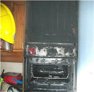 Firefighter at the scene of an unattended cooker fire in Warrington