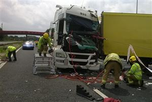 Firefighters making lorry in M6 road traffic collision safe