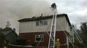 Firefighters tackling a house fire in Mouldsworth