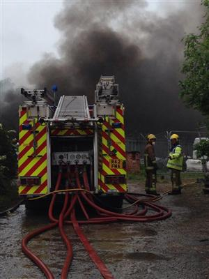 Firefighters and fire engines at the scene of a large fire in Ellesmere Port