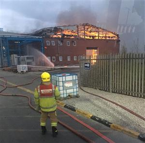 Firefighter at the scene of the warehouse in Widnes