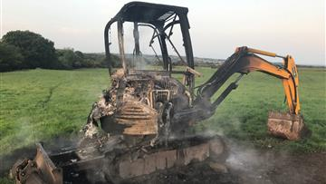 Digger on fire in Scholar Green