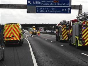 Ambulance, Air Ambulance and fire engines at a road traffic collsion on the M6