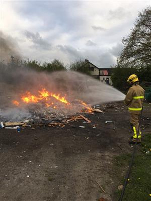 Firefighter tackling a fire in Millington