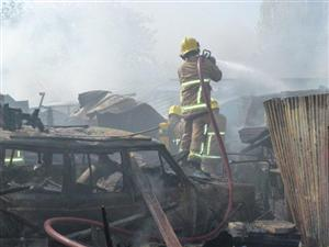 Firefighters tackling the blaze involving a derelict caravan