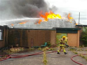Crews tackle a building fire in Crewe