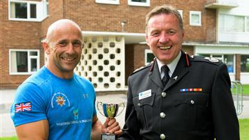 Cheshire Firefighter Challenge winner with Assistant Chief Fire Officer Gus O'Rourke