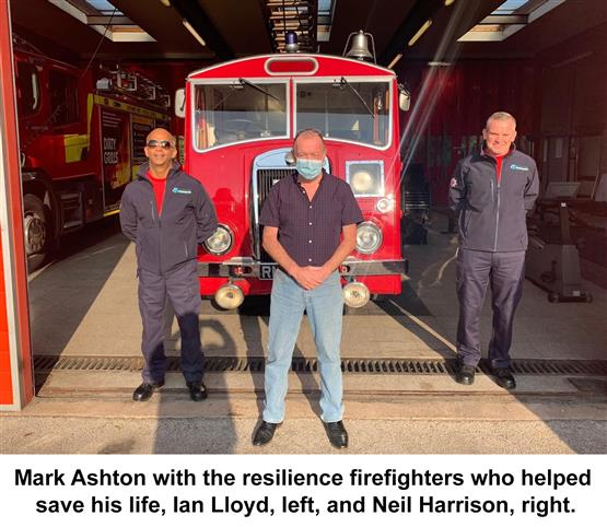 Mark Ashton with the resilience firefighters who helped save his life, Ian Lloyd, left, and Neil Harrison, right