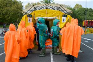 Students in decontamination suits
