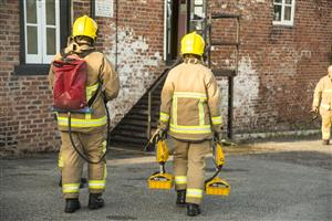 Firefighters at the scene of a fire