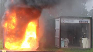 CFRS sprinkler demo - two identical rooms apart from only one has sprinkler fitted